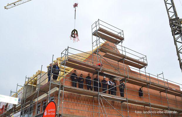 Richtfest für den Neubau eines Wohn- und Geschäftshauses am Objekt Markt 6/7 in Herzberg